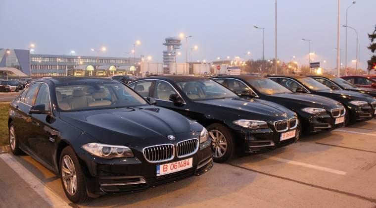 Romani vor modele BMW negre si Mercedes-Benz albe