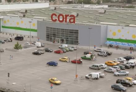 Cora va construi statii de incarcare a masinilor electrice in toate magazinele sale