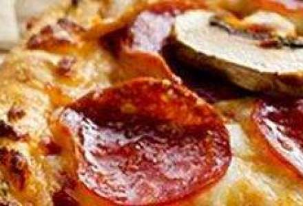 Lantul de franciza Domino's Pizza, extins in marile orase