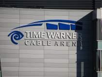 AT&T vrea sa cumpere Time...
