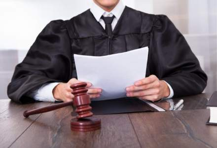 Curtea Constitutionala a admis unele sesizari privind Legea darii in plata