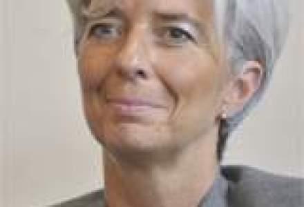 Angela Merkel o sustine pe Christine Lagarde pentru sefia FMI