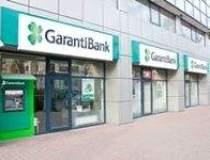 Garanti Bank vrea sa ia pana...