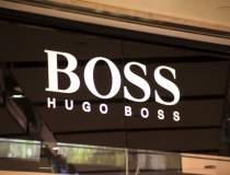 Hugo Boss reduce numarul...