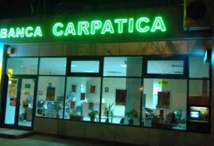 BNR a aprobat fuziunea Bancii Carpatica cu Patria Bank