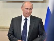 Putin a asistat la slujba de...