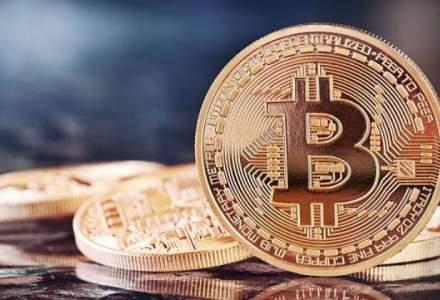 Bitcoin a atins un nivel record de peste 1.200 de dolari pe unitate