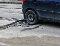 """""""Craterele"""" din asfalt,..."""