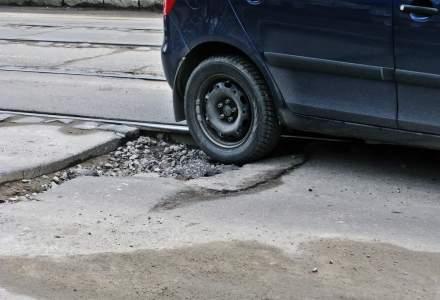 """""""Craterele"""" din asfalt, calvarul soferilor din Bucuresti: costul repararii unei singure gropi urca la 1.500 de euro, insa riscul soferilor este unul urias. Ce solutii exista?"""