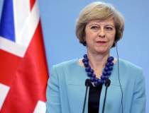 Premierul Theresa May va...