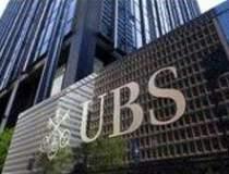 Sute de bancheri UBS ar putea...