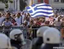 Premierul elen a renuntat la...