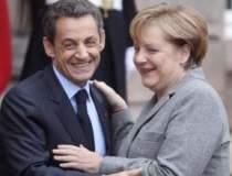Merkel si Sarkozy vor sa...