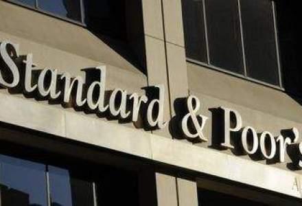"""S&P a coborat ratingul OTP la """"junk"""""""