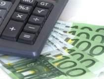 Euro scade sub 1,28 dolari...