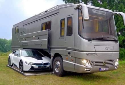 Lux de cinci stele in 12 metri de autobuz cu garaj si un BMW i8...