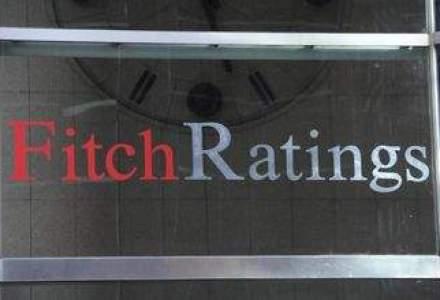 Fitch a retrogradat ratingul Spaniei cu trei trepte, cu perspectiva negativa