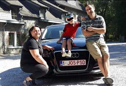 """Roman plecat in Belgia anunta ca se intoarce in tara. """"JOS PSD"""", numarul de inmatriculare al masinii"""
