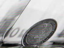 Fitch: Romania va adopta euro...