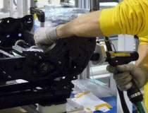 GM raporteaza profit peste...