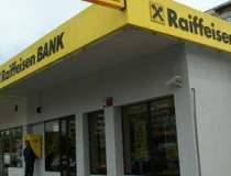 Profitul Raiffeisen Bank a...