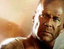 Bruce Willis vrea sa dea in...