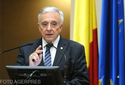 """Mugur Isarescu este dispus sa discute despre taxa pe active doar intr-o sedinta CNSM, nu """"la o sueta, la televizor"""""""