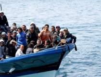 Cel putin 15 migranti au...
