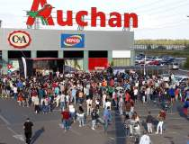 Reactia Auchan dupa amenda de...