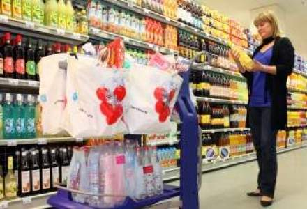 Tranzactia Auchan - Real, pe ultima suta de metri?