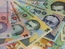Moneda nationala s-a...