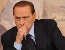 Factura de divort: Berlusconi...