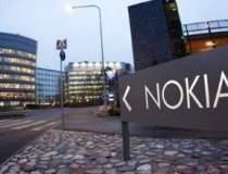 Nokia raporteaza pierderi de...