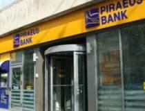 Piraeus Bank vrea sa cumpere...