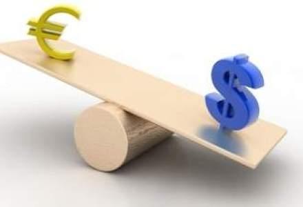 Euro ar putea ajunge la acelasi nivel cu dolarul in urmatorii doi ani