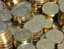 Bitcoin, moneda care profita...