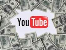 YouTube va introduce taxa pe...