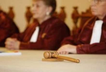 Curtea Constitutionala discuta azi sesizarea PDL privind legea retrocedarilor