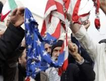 Mii de irakieni au scandat...