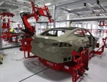 Tesla vrea un centru de...
