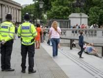 Politia britanica a impuscat...