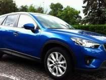 Mazda anunta vanzari in...