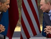 Obama si Putin urmau sa...