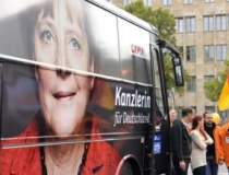 Merkel castiga alegerile, dar...