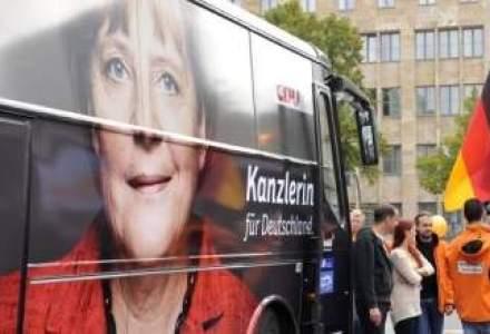Merkel castiga alegerile, dar va fi nevoita sa guverneze cu opozitia