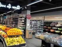 Auchan va livra comenzi...