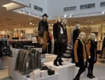 H&M inchide anul cu 30 de...