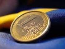 Romania's leu inches to...
