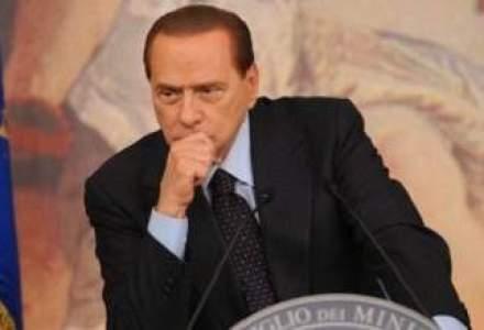 Silvio Berlusconi, huiduit de zeci de manifestanti la intrevederea cu liderul PD