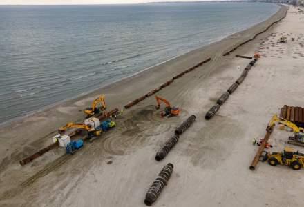 FOTO | A început a doua fază de înnisipare de pe litoralul românesc. Cu cât se vor mări plajele